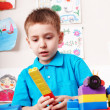 Child playing block and construction set. — Stock Photo