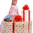 Child in santa hat holding red gift box. — Stock Photo