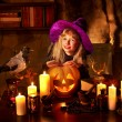 Witch with pumpkin lantern. — Stock Photo