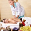 Young woman on massage table in beauty spa. — Stock Photo