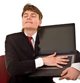 Businessman with laptop in office. — Stock Photo