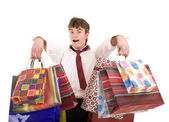 Businessman with pile shopping bag . — Stock Photo