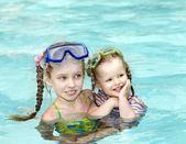 Children swim in swimming pool. — Stock Photo