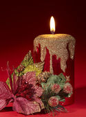 Christmas candle and poinsettia. — Stock Photo