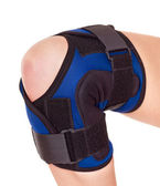 Trauma of knee in brace. — Stock Photo