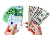 Exchange dollars to euro money in female hand. — Stock Photo