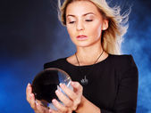 Young woman with crystal ball. — Stock Photo