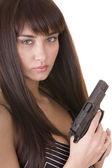 Beautiful young woman with gun. — Stockfoto