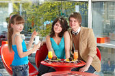 Happy family with child in cafe. — Stock Photo