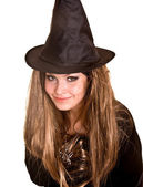 Witch in black dress and hat. — Stock Photo