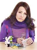 Girl having flu taking pills — Stock Photo