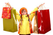 Girl in autumn orange hat with shopping bag group. — Stock Photo