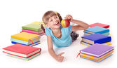 Child with pile of books reading on floor. — Stock Photo