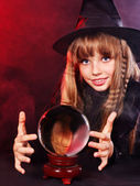 Girl holding crystal ball. — Stock Photo