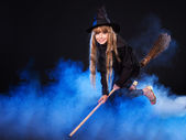 Witch flying on broomstick. — Stock Photo