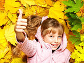 Kid in autumn orange leaves. — Foto de Stock