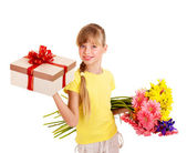Child holding gift box and flowers. — Stock Photo