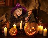 Witch with pumpkin lantern. — Stock Photo