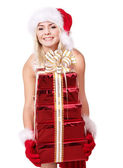 Girl in santa holding stack gift box. — Stock Photo