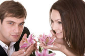 Couple of girl and man love flower. — Stock Photo