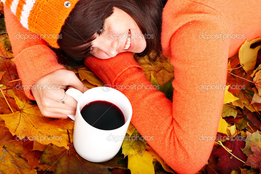 Girl in autumn orange leaves with cup coffe. Outdoor. — Stock Photo #7111454