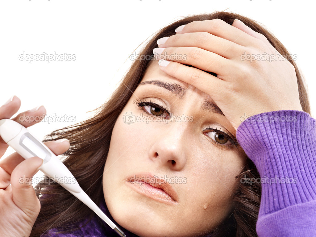 Young woman having  flue  taking thermometer. Isolated.  Stock Photo #7111682