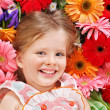 Cute child lying on the flower. — Stock Photo