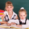 Stock Photo: Schoolchildren in classroom near blackboard.