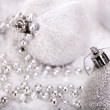 Christmas ball and beads in snow. — Stock fotografie