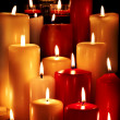 Group of  candles on  black background. - Stock fotografie
