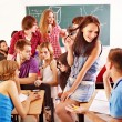 Student in classroom near blackboard. — Stock Photo