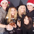 Group young in santa hat at nightclub. — Stock Photo