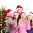 Foto Stock: Group young in santa hat.