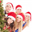 Group young by christmas tree. — Foto Stock