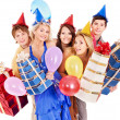 Group of young in party hat holding gift box. — Stock Photo