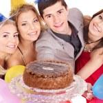 Group holding cake. — Stock Photo