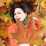 Girl in autumn orange leaves. — Stock Photo