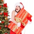 Christmas girl in santa holding gift box. — Stockfoto
