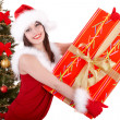 Christmas girl and fir tree with red gift box. - Stock fotografie