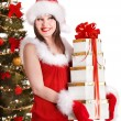 Christmas girl in santa holding stack gift box. - Stock fotografie