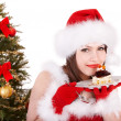 Royalty-Free Stock Photo: Christmas girl in santa hat and cake on plate.