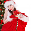 Girl in santa holding christmas socks and gift box. - Foto Stock