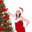 Christmas girl in santa hat holding stack  gift box. - Foto Stock