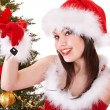Christmas girl in santa hat holding auto keys. - Photo