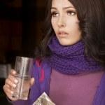 chica tener gripe tomando pastillas — Foto de Stock   #7258672