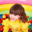 Happy child in group colorful ball. - Stock Photo