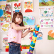 Child playing  block and construction set in play room. — Stock Photo