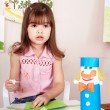 Child preschooler play glue in classroom. — Stock Photo