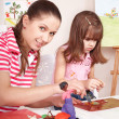 Mother and  daughter playing plasticine. — Stock Photo