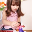 Child moulding of plasticine . - Stock Photo